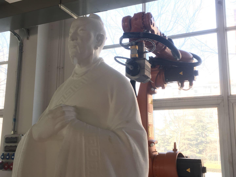 【网络媒体走转改】写春联、雕刻孟子,这些活机器人都能干!