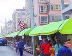 青岛北岭山吉安路摊点群4月25日将取缔 周边将建五星级农贸市场