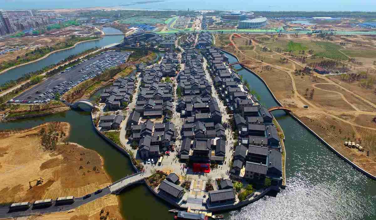 首届中国(日照)新闻摄影周启动 昔日渔村华丽变身旅游小镇
