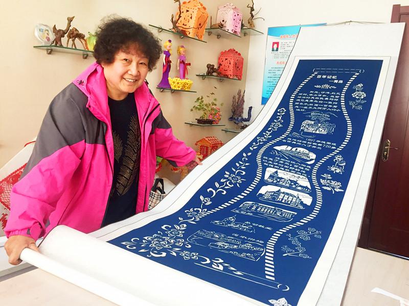 剪纸达人创作3.5米长作品 将青岛百年历史记录纸上