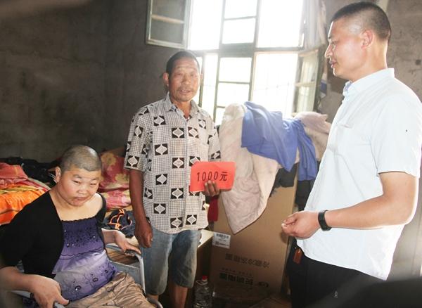 枣庄村级慈善协会暖人心 17户家庭领到两万多救助款