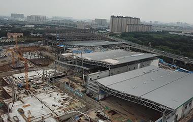 飞吧山东|济南西部会展中心展馆主体钢结构封顶在即 明年5月底竣工
