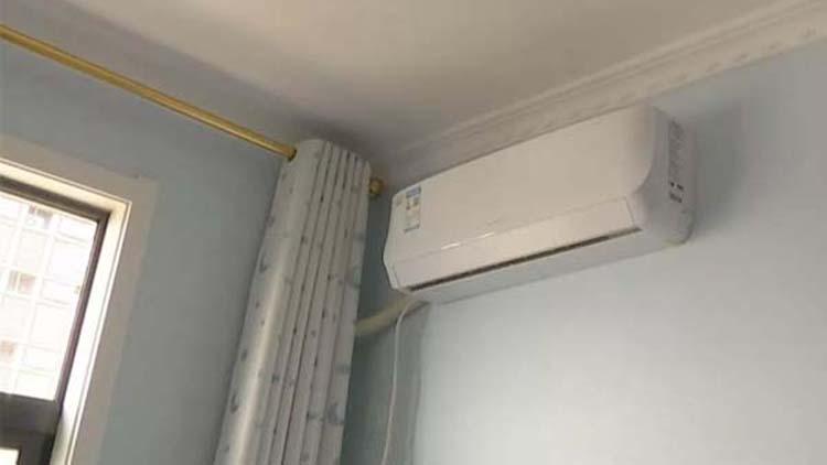 肥城女子买四台空调可能均为假货 找上门后商场老板自扇耳光