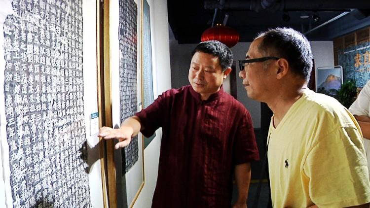 86秒丨120幅龙门石窟拓本亮相潍坊金石文化周 6大版本对比展出
