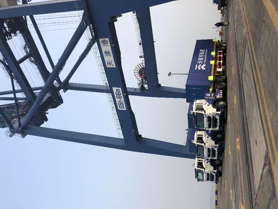 全球首秀!中国重汽25辆智能纯电动集卡天津港整船作业