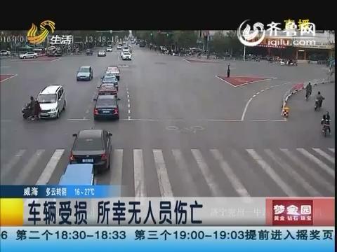 济宁:电动车闯灯 撞上面包车