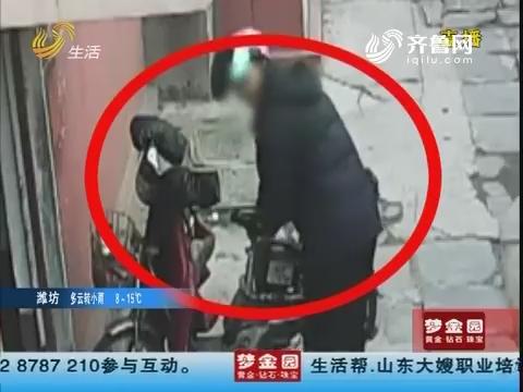 青岛:直击监控底下 男子偷电瓶