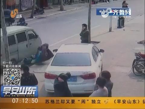淄博:一言不合 司机狂轧电动车