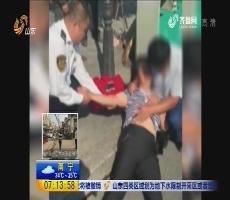 青岛:乘客下车晕路边 6名公交司机伸援手
