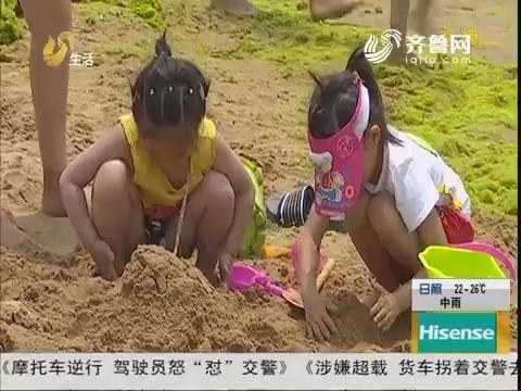 洗海澡!青岛浴场换新沙