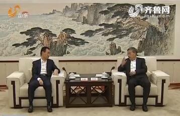 郭树清会见万达集团董事长王健林