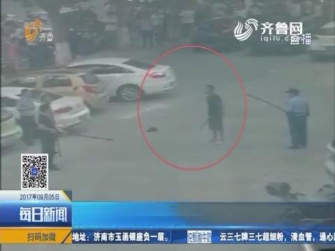 高密:不好!男子持刀广场上闹事