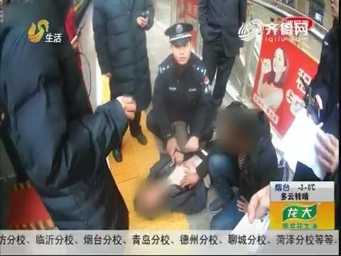 青岛:危急!火车站 男子欲跳10米台