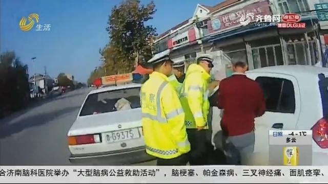 潍坊:开车去买花 与警车擦肩而过